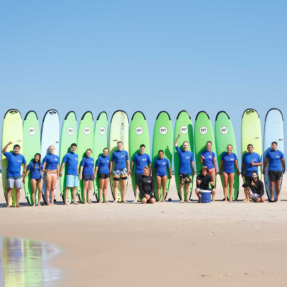 group surf lessons byron bay