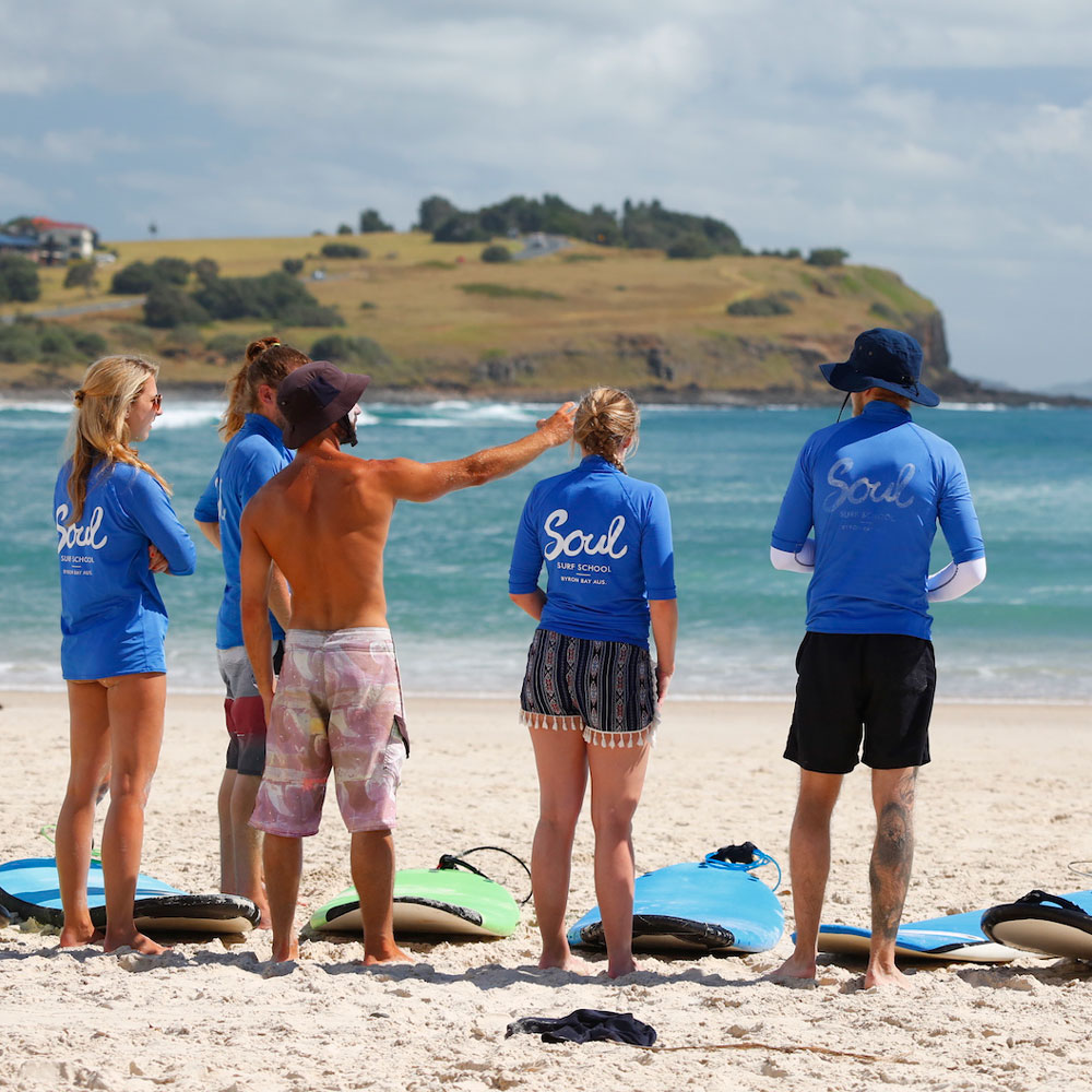 corporate surf lessons byron bay
